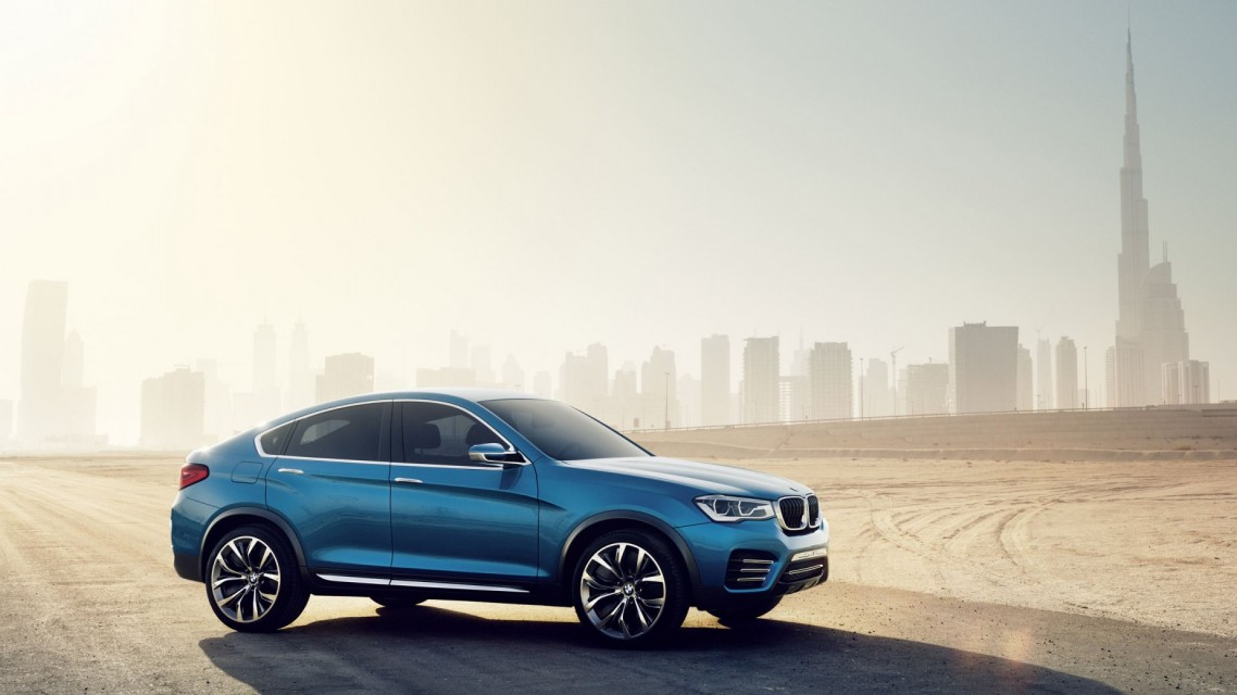 Auto___BMW___Others_BMW_The_blue_BMW_X4_crossover_on_the_city_landscape_048122_